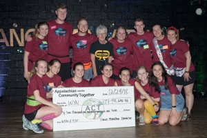 The Dance Marathon committee posing with the director of Parent to Parent Kaaren Hayes and the check